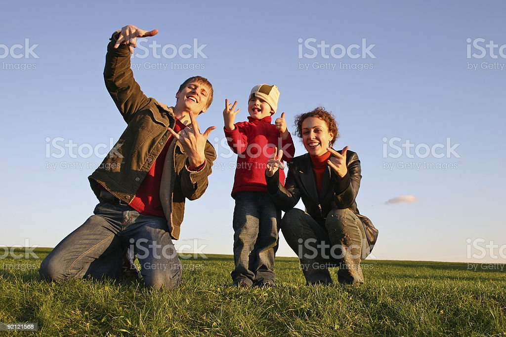 family with fingers on grass royalty-free stock photo