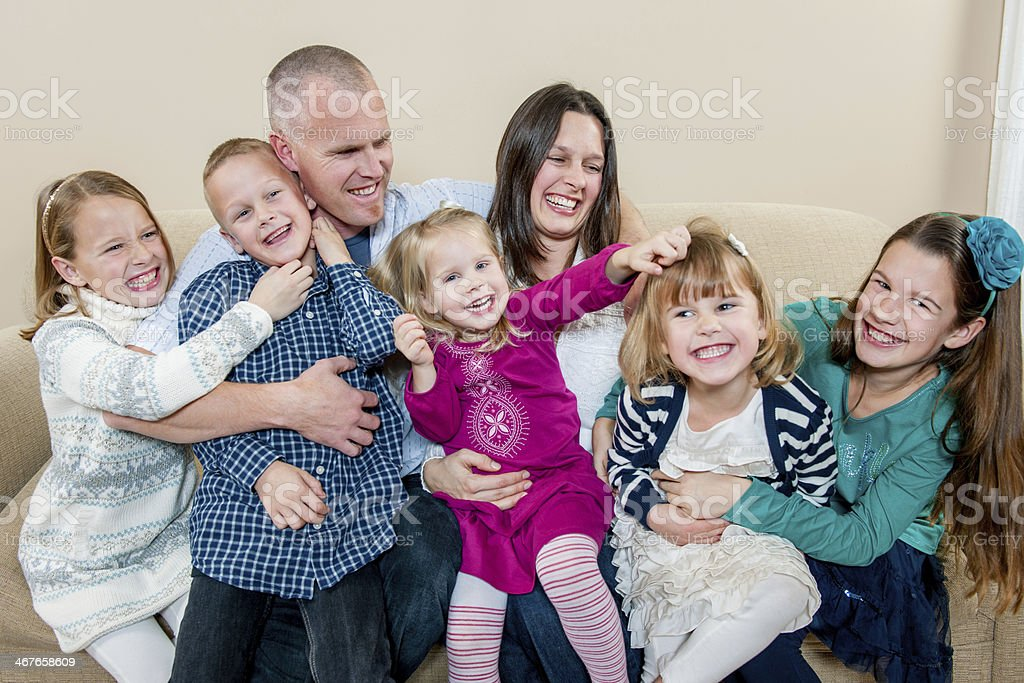 Family with five kids stock photo