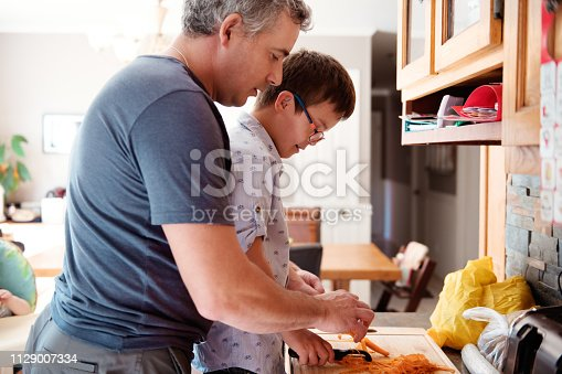 istock Family with four childs whom two are down's syndrome and autism 1129007334
