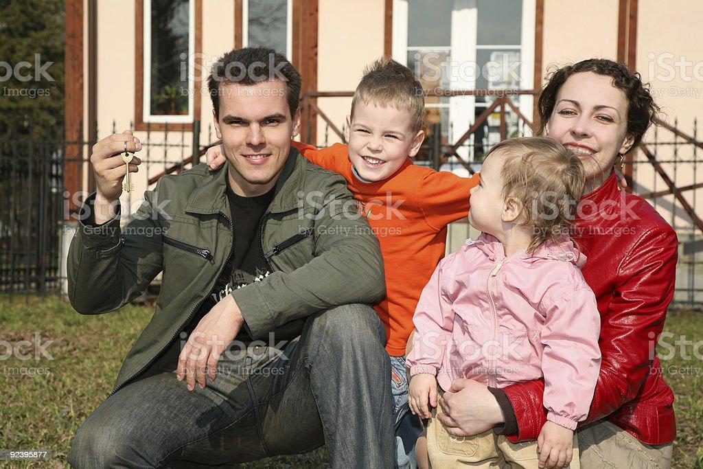family with house key royalty-free stock photo