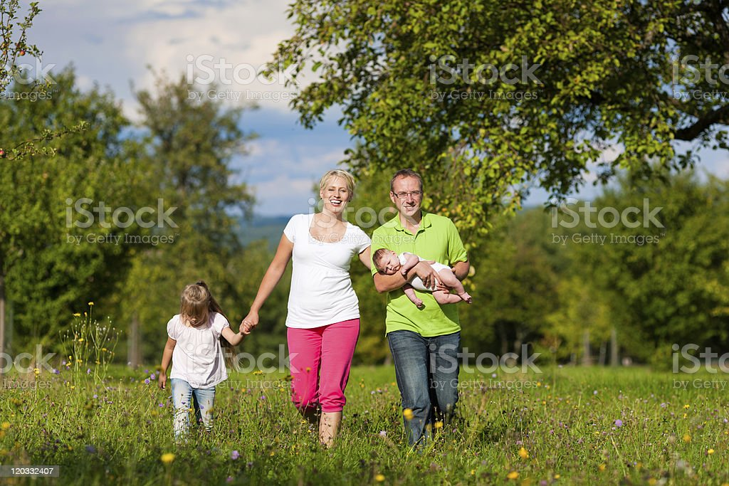 Family with kid having walk in summer royalty-free stock photo