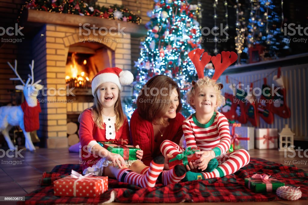 Family With Kids At Christmas Tree And Fireplace Stock Photo & More ...