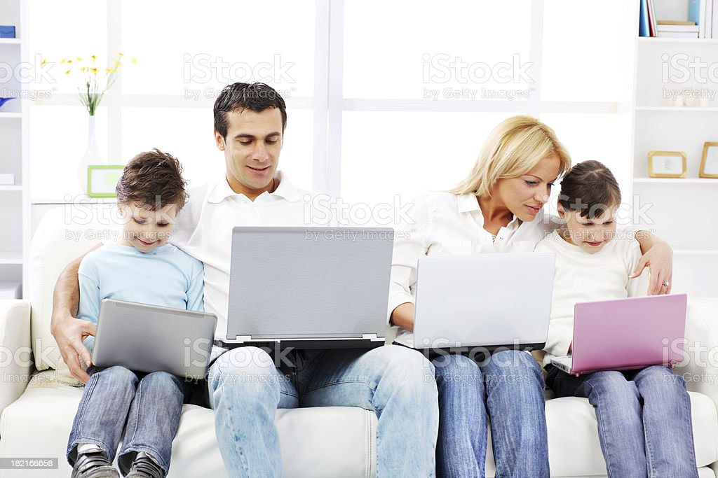 Family with laptops. royalty-free stock photo