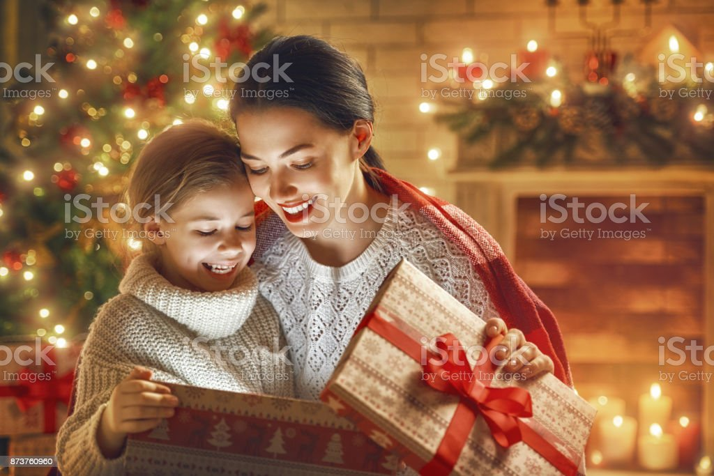 family with magic gift box stock photo