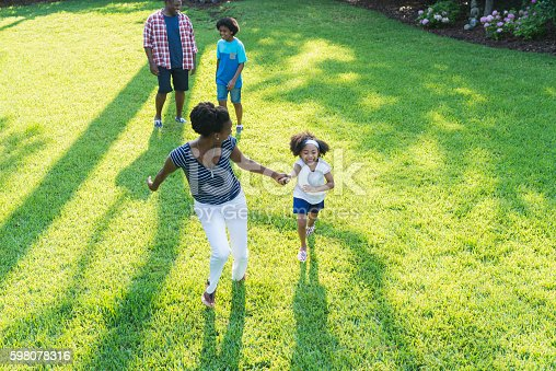 589135214 istock photo Family with mixed race children outdoor playing, walking 598078316