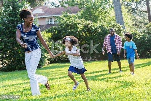 istock Family with mixed race children outdoor playing, walking 599764812