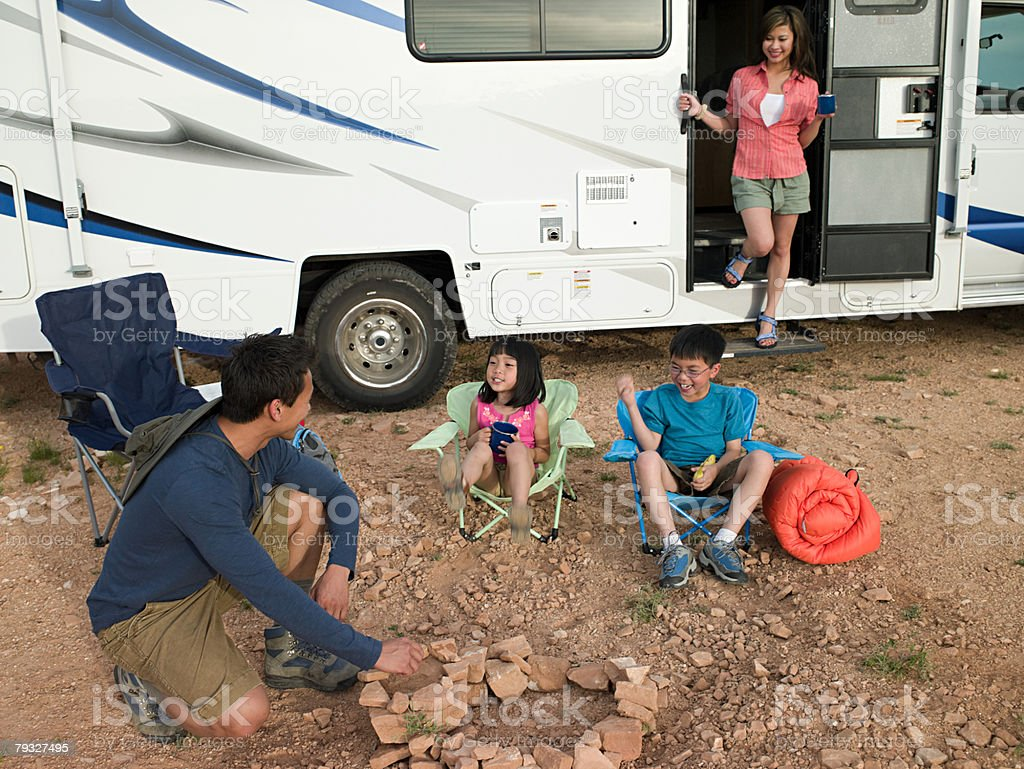 Family with motor home royalty-free stock photo