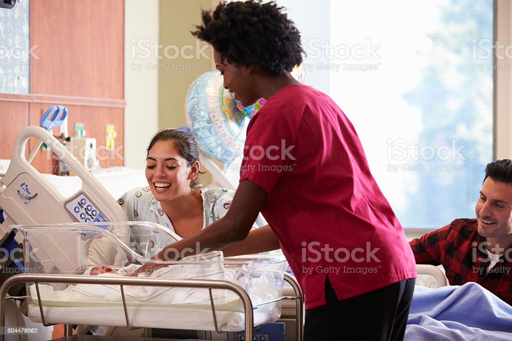 Family With New Born Baby In Post Natal Department stock photo