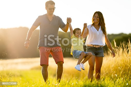 istock family with one child boy enjoing walk outdoors in summer sunshine in rural landscape 995523586