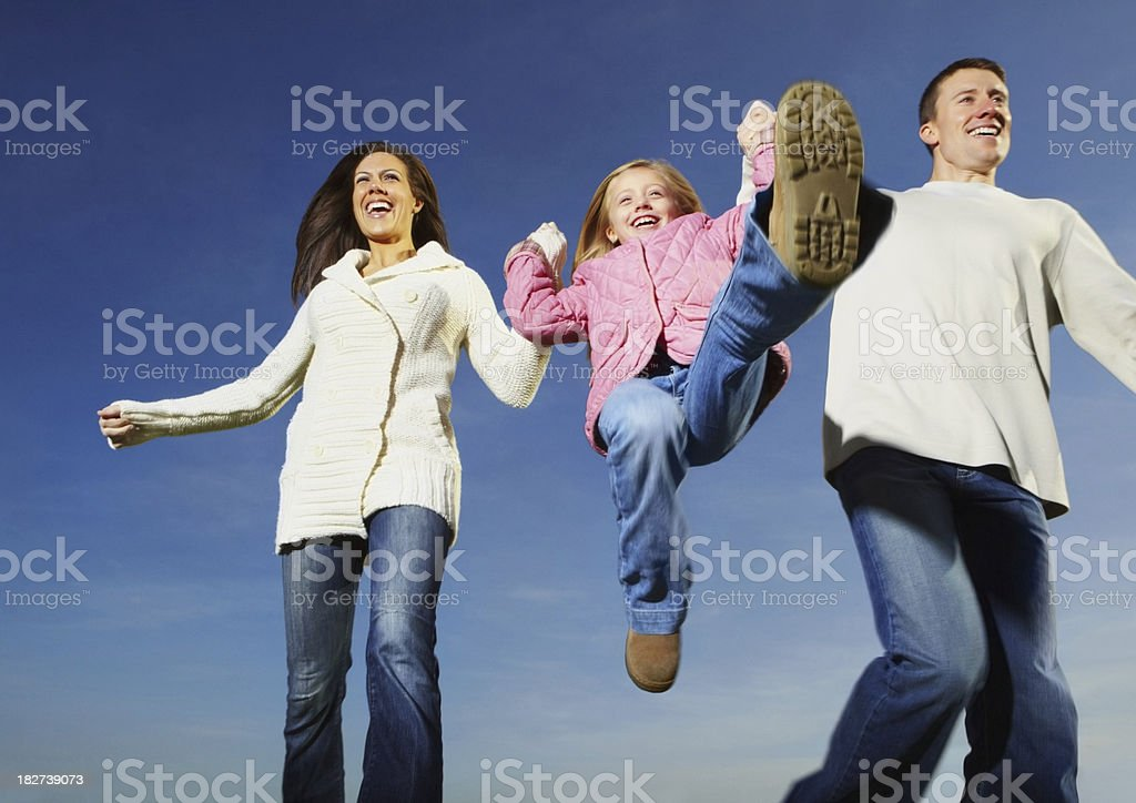 Family with one children having fun outdoors royalty-free stock photo