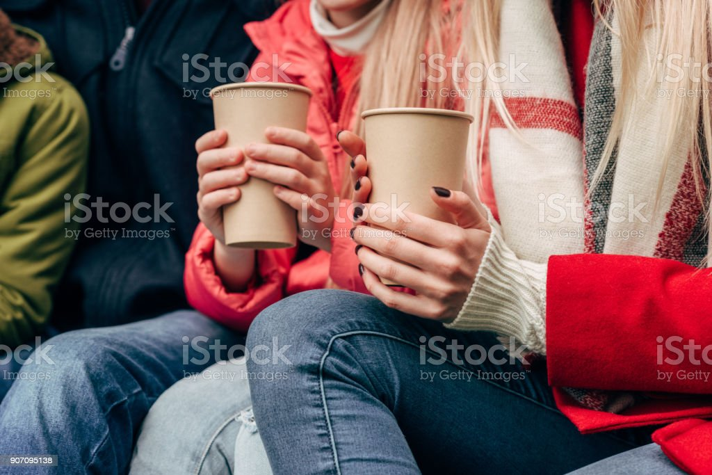 family with paper cups stock photo