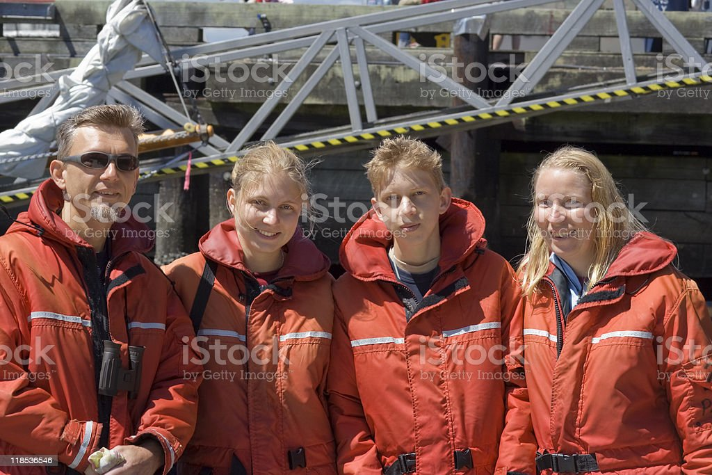 Family with red Floatation Suits royalty-free stock photo