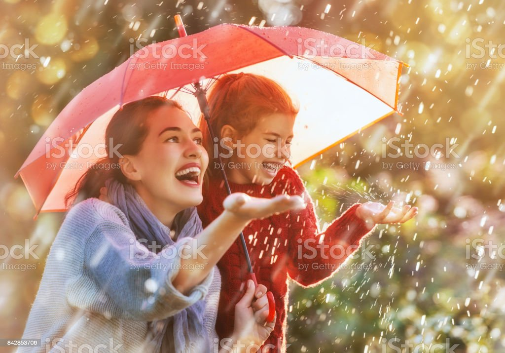 family with red umbrella stock photo