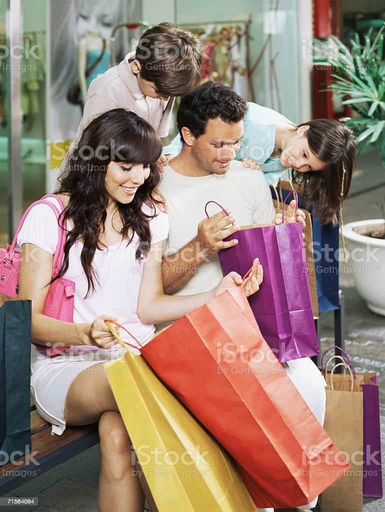 Family with shopping bags royalty-free stock photo