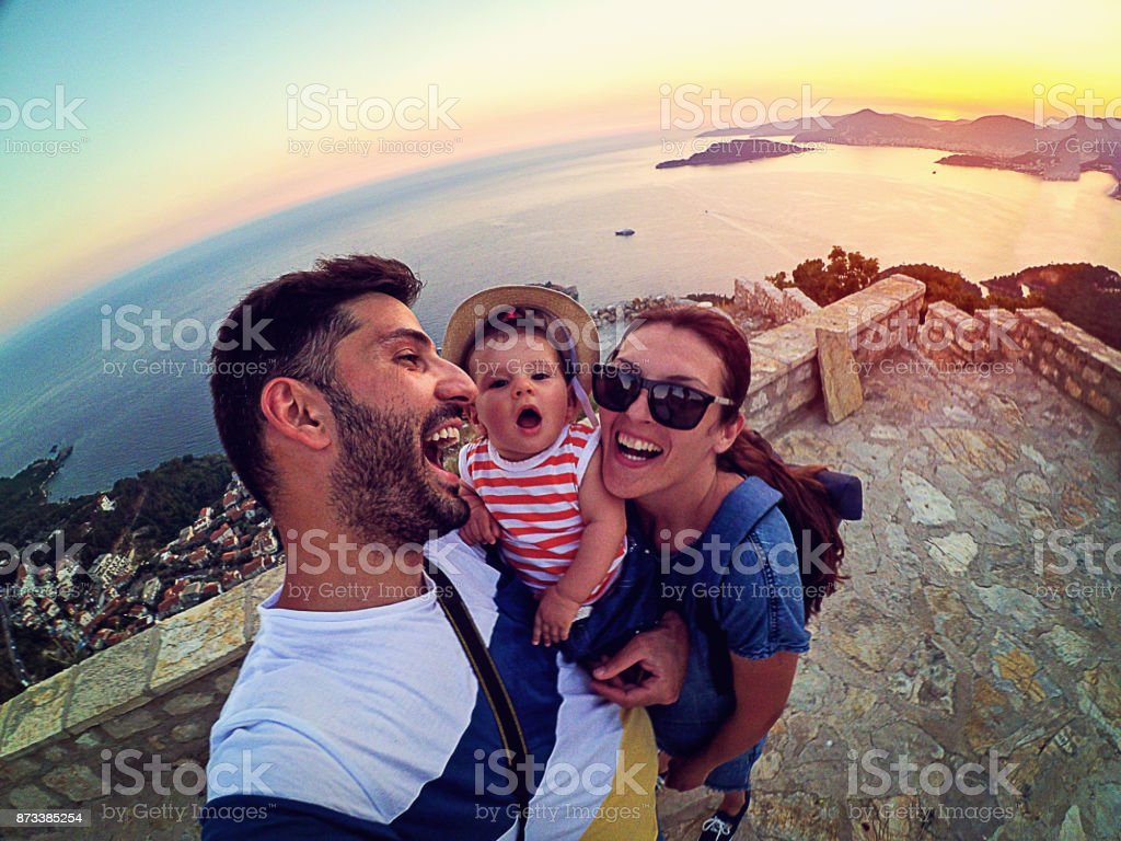 Family with small daughter making selfie while travel stock photo