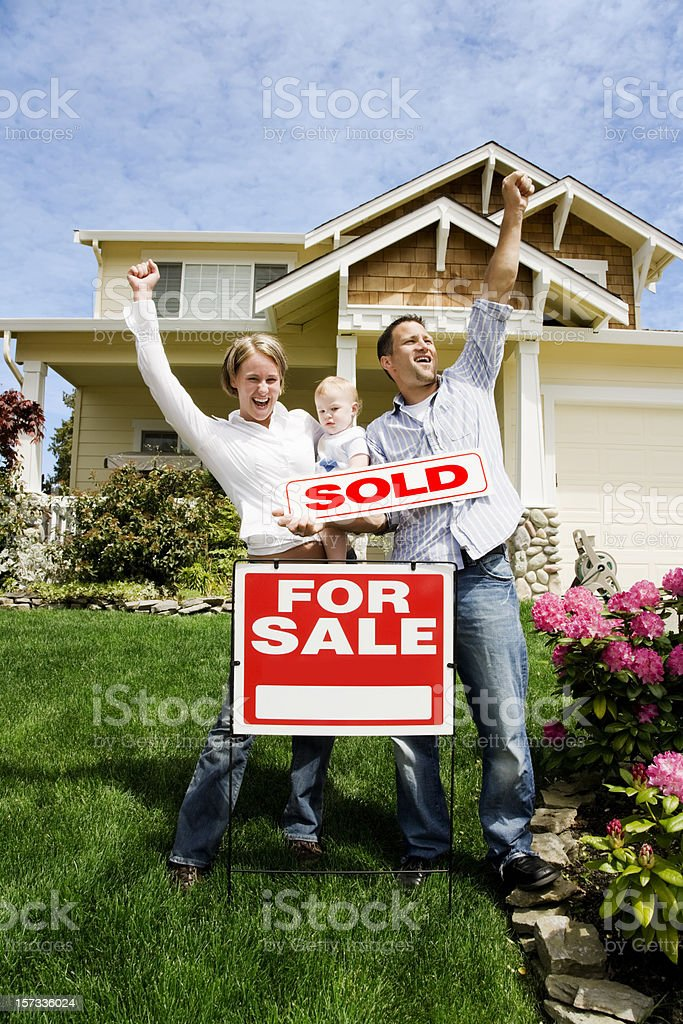 Family with Sold Home stock photo
