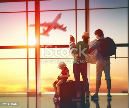 istock family with suitcases 521465442