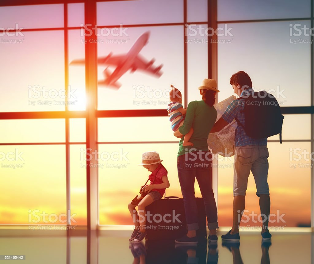 family with suitcases stock photo
