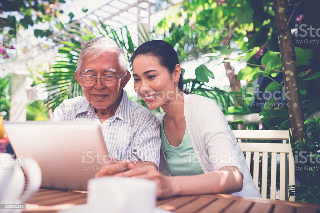 Family with tablet computer stock photo