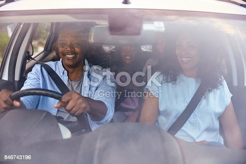 istock Family With Teenage Children In Car On Road Trip 846743196