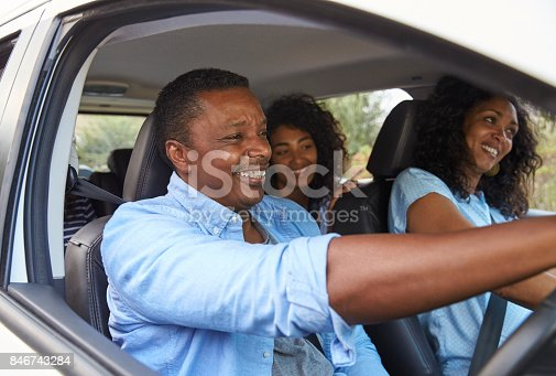 istock Family With Teenage Children In Car On Road Trip 846743284
