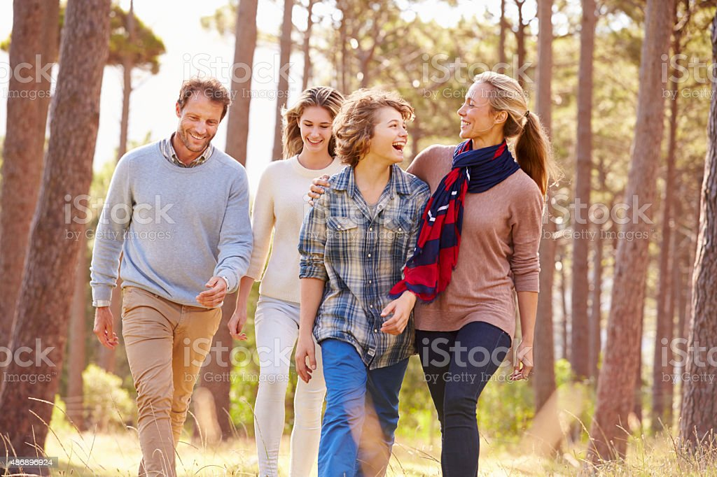 Family with teenage kids walking in the countryside stock photo