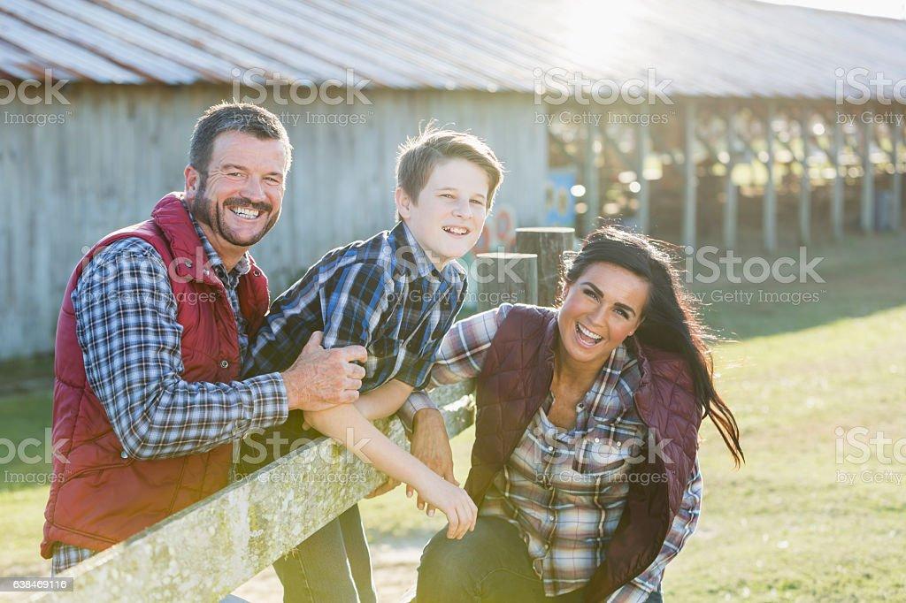 Family with teenage son on a farm stock photo