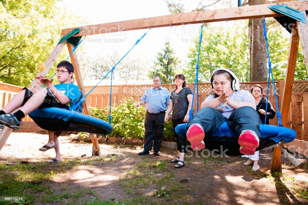 Family with their Autistic and Down Syndrome Twins brother and sister in daily lives stock photo