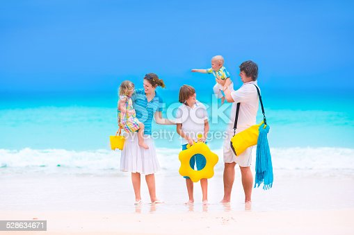 693519466 istock photo Family with three kids at a tropical beach 528634671