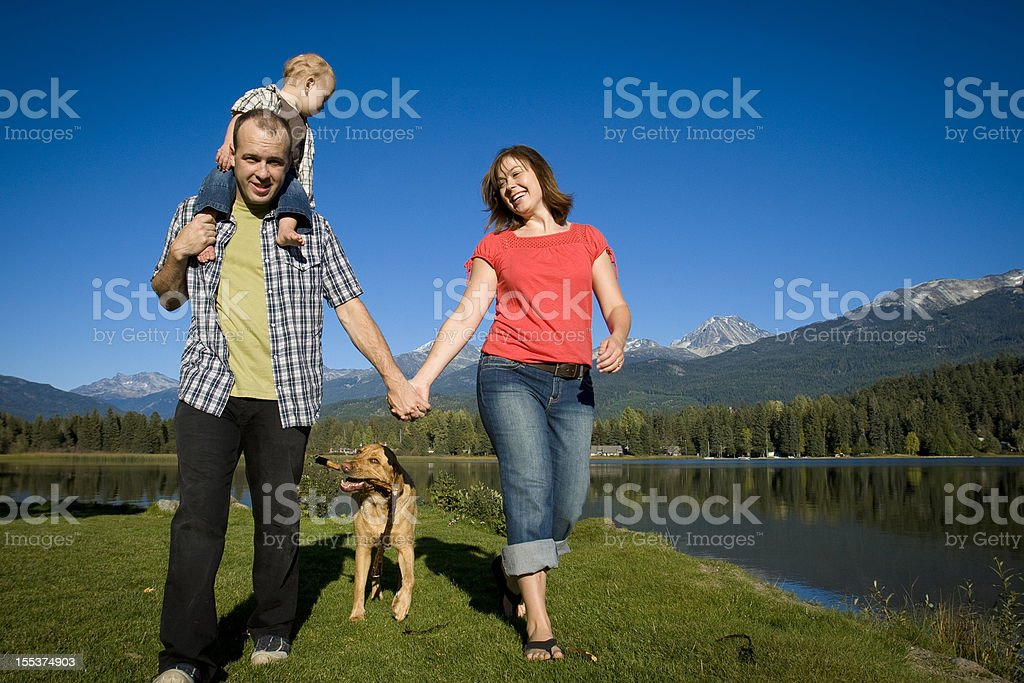 Family with toddler playing in park. royalty-free stock photo