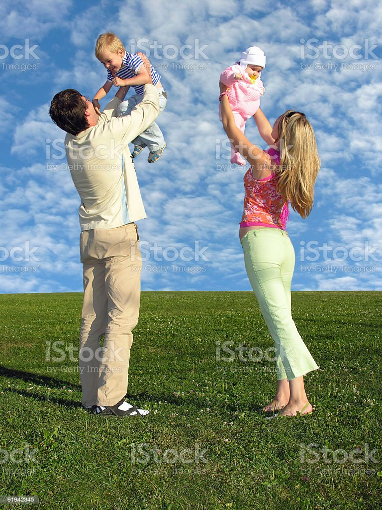 family with two children and cloudfield stock photo