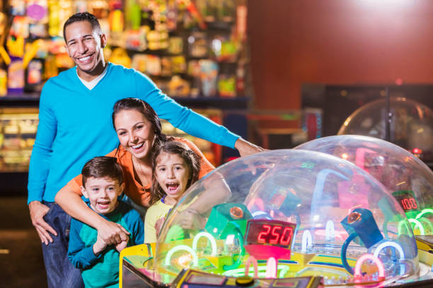 Family with two children in amusement arcade stock photo