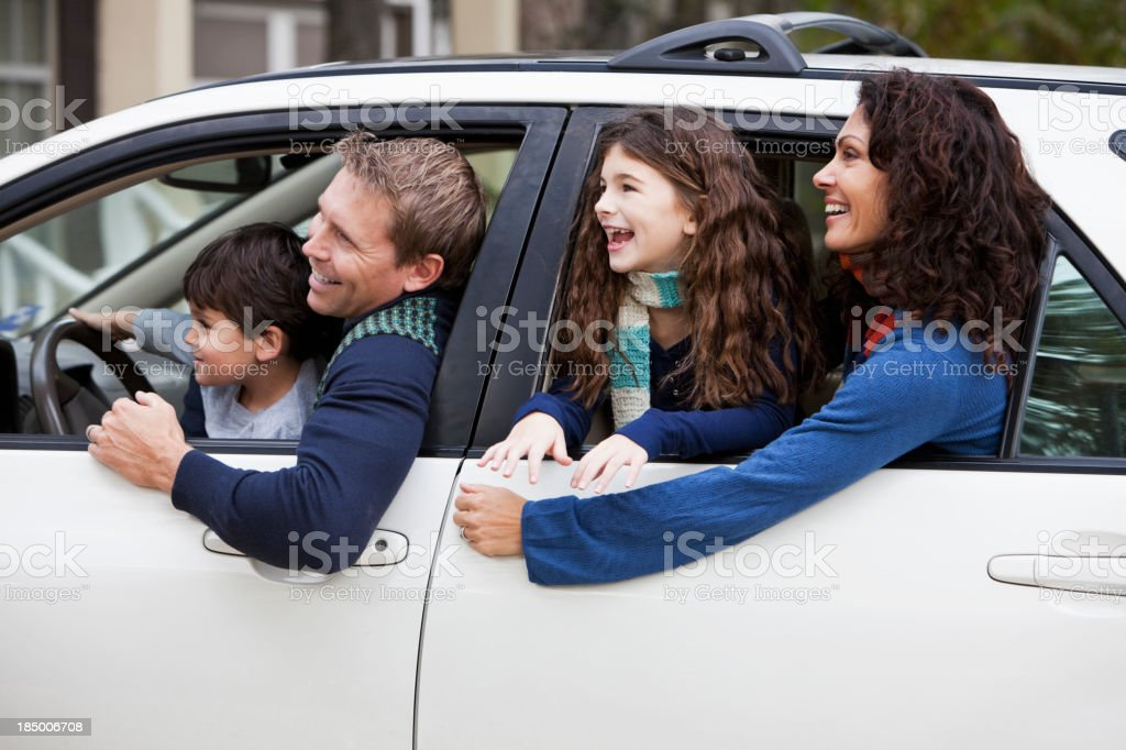 Family with two children in car royalty-free stock photo