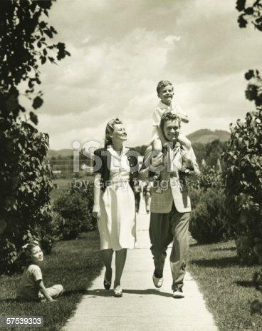 57520540 istock photo Family with two children (4-5) on walk, (B&W) 57539303