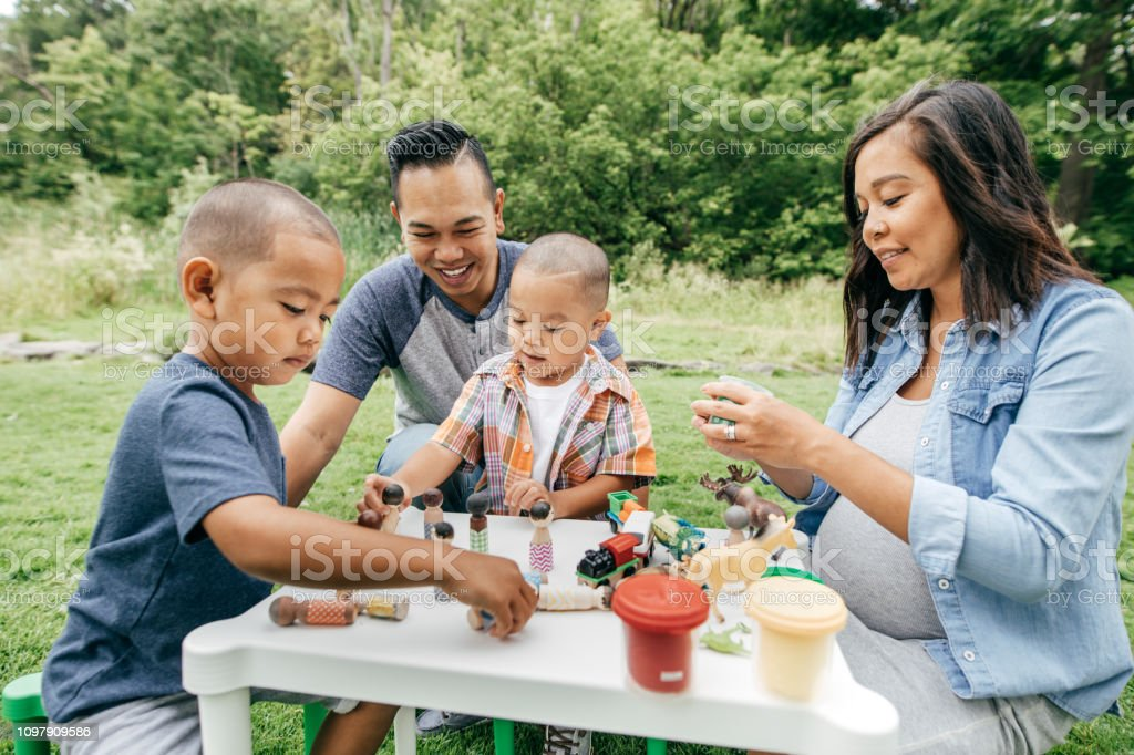 Family with two kids in the park stock photo