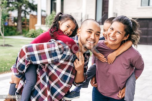 1082195070 istock photo Family with two kids looking at camera 1035595572