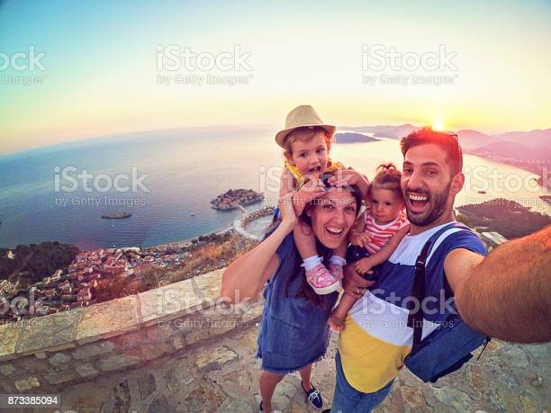 Family with two little daughters travel in nature making selfie picture id873385094?b=1&k=6&m=873385094&s=612x612&h=5uvlp3chbjig hsp1w6z5oeppb pw6lfuyc0ybw3es0=