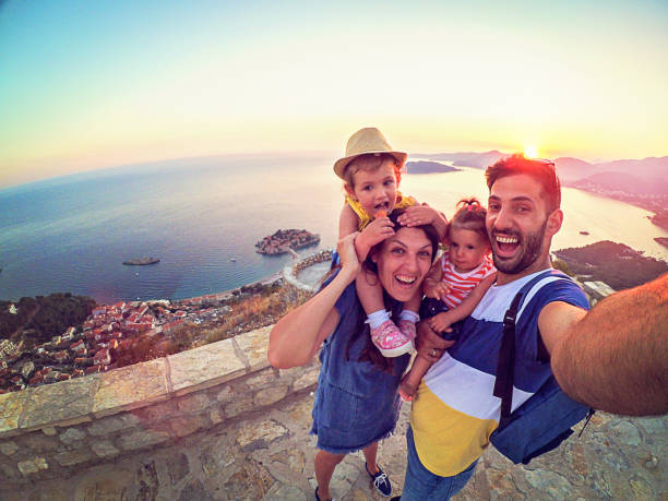 family with two little daughters travel in nature, making selfie, smiling - travel imagens e fotografias de stock