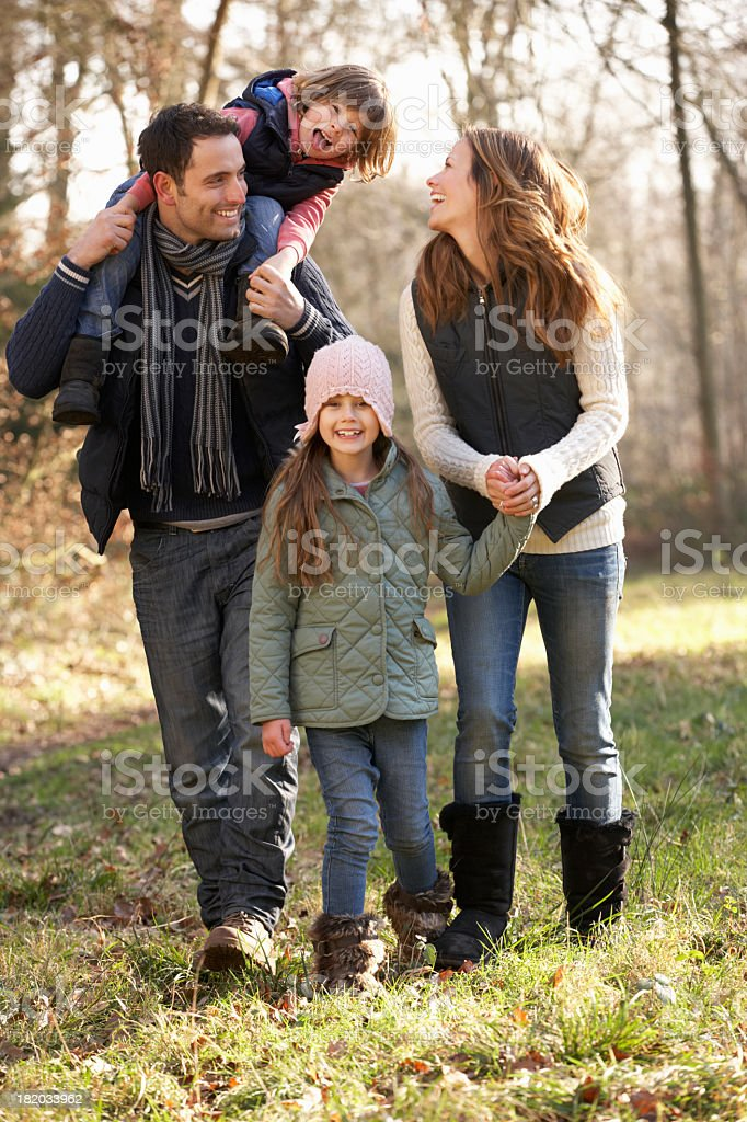 Family with two young daughters outdoors in winter royalty-free stock photo