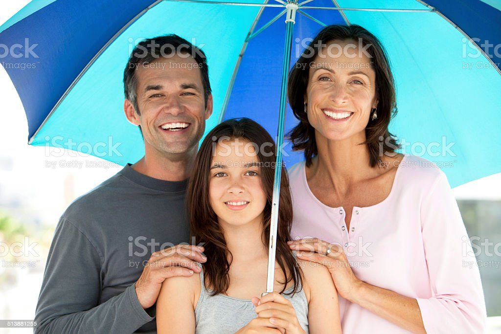 Family with umbrella stock photo