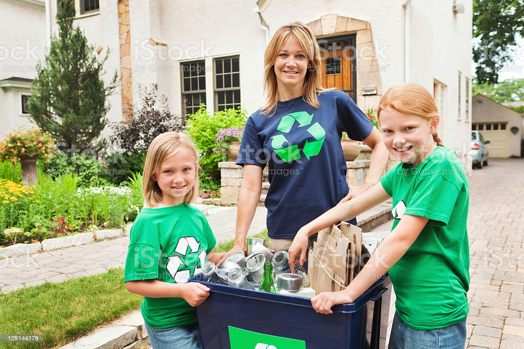Family Working Together in Community Recycling Effort Hz royalty-free stock photo