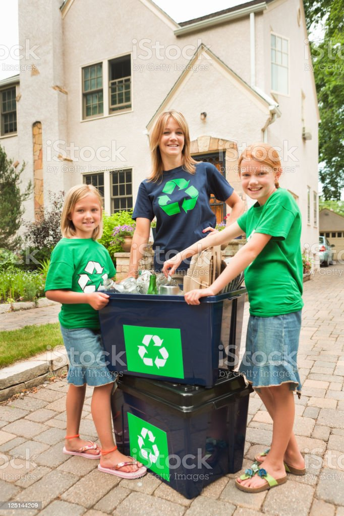Family Working Together in Community Recycling Effort Vt royalty-free stock photo