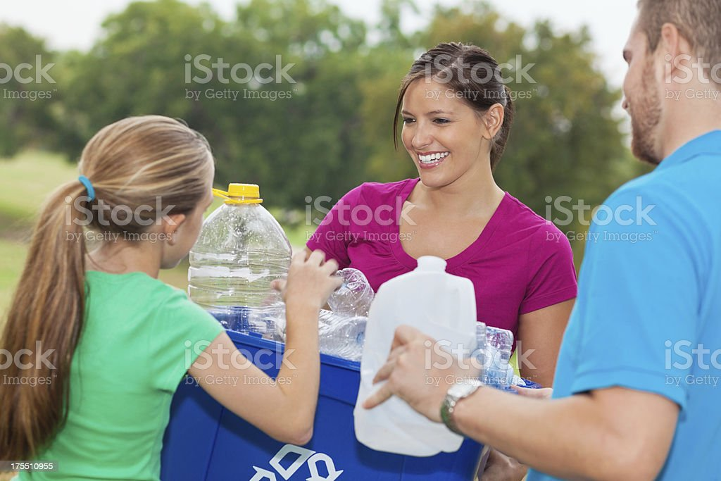Family working together to collect recycle materials royalty-free stock photo