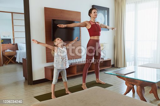 916126642 istock photo Family Workout At Home. Mother And Daughter Exercising In Living Room. Little Girl And Young Woman Practicing On Mat. Sport Routine For Active Lifestyle. 1226234240