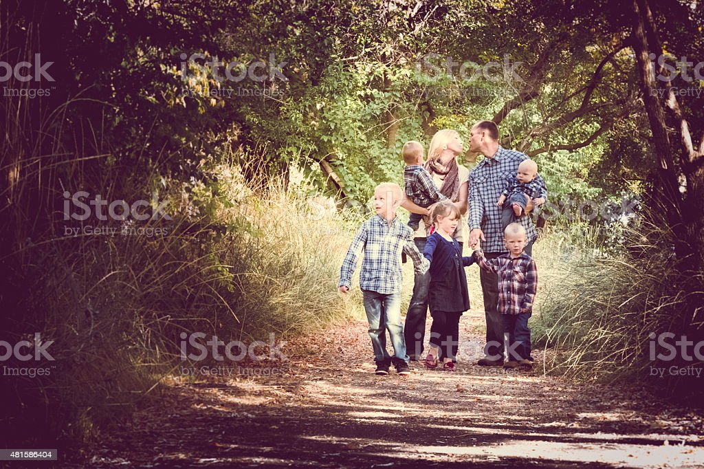 Family - Young Adult Couple & Five Children Outdoors  Nature stock photo