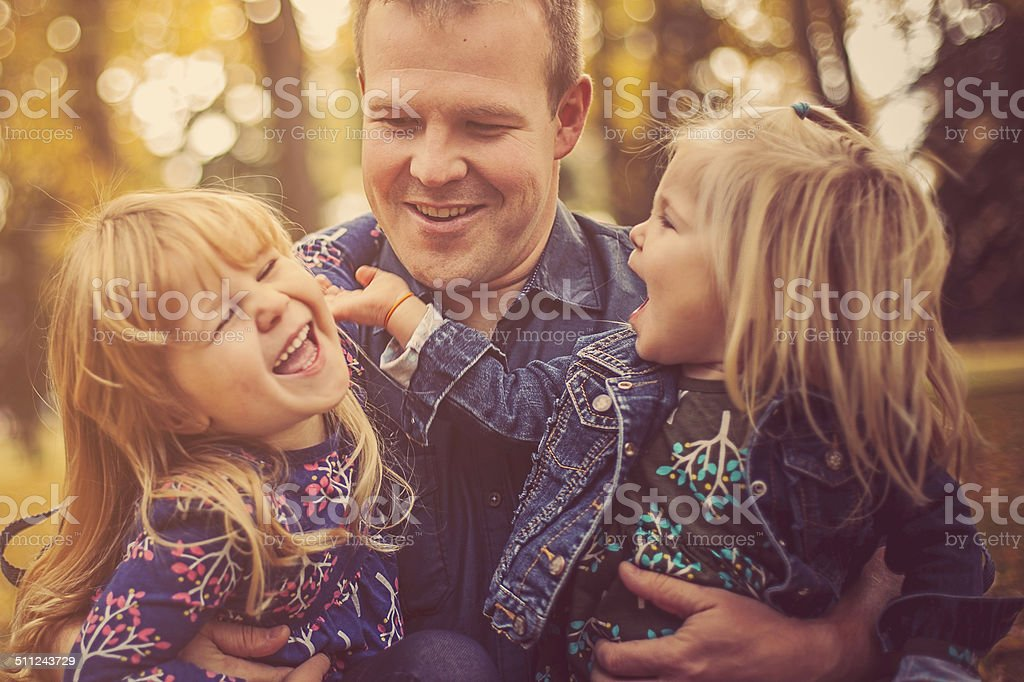 Family-Dad With His Two Girls stock photo