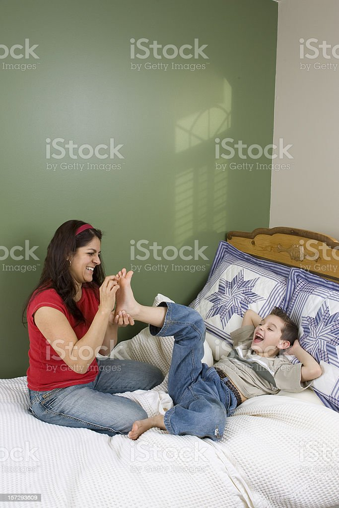 Family-Mother and Son Tickling Feet stock photo