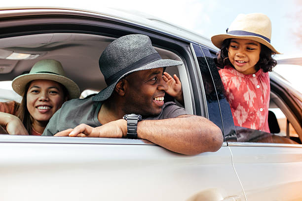 family's  road trip - asian travel in car stock photos and pictures