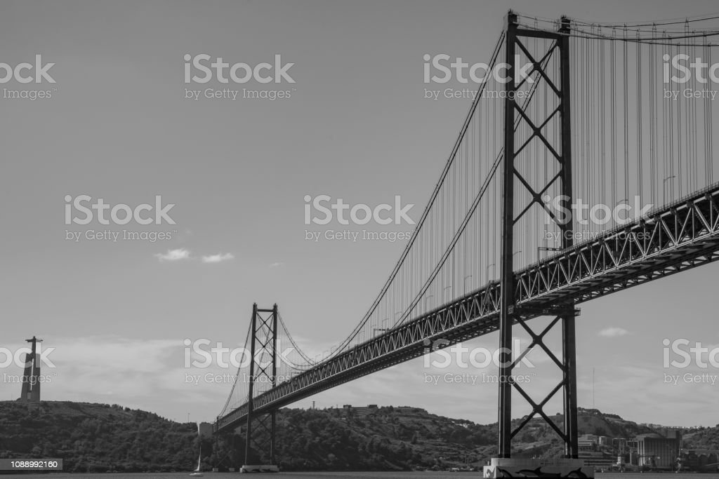 (sepia) Famous 25 de Abril bridge over Tagus in Lisbon, Portugal stock photo