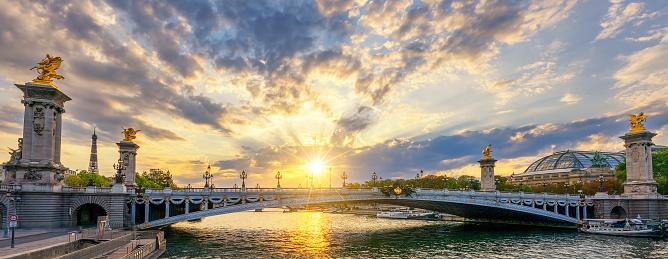 Famous Alexandre III bridge in Paris at sunset, France